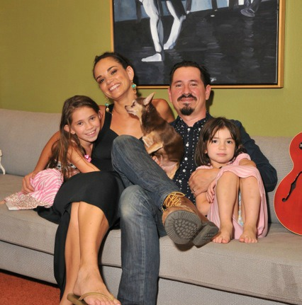 Celeste and Adrian Quesada with their girls and the family pup.
