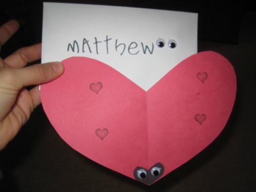 "For a six-year-old: Cut out heart with red construction paper. Kid used black stamps to put ""spots"" on ladybug. He attached the smaller heart I cut out and we used peel off Googly eyes for the eyes. He wrote Happy Valentine's Day and signed each and addressed them."