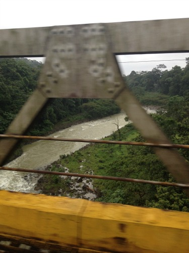 One of the many bridges we crossed over rain-swollen rivers on our way to La Fortuna. Many bridges were one lane only.
