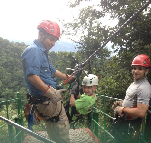 My  fearless 8-year-old, ziplining through the treetops near Arenal.