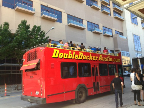 A Double Decker Austin bus, loaded up with passengers from the Austin Visitor Center.