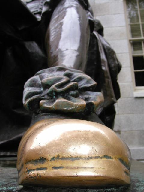 Rubbing John Harvard's toe