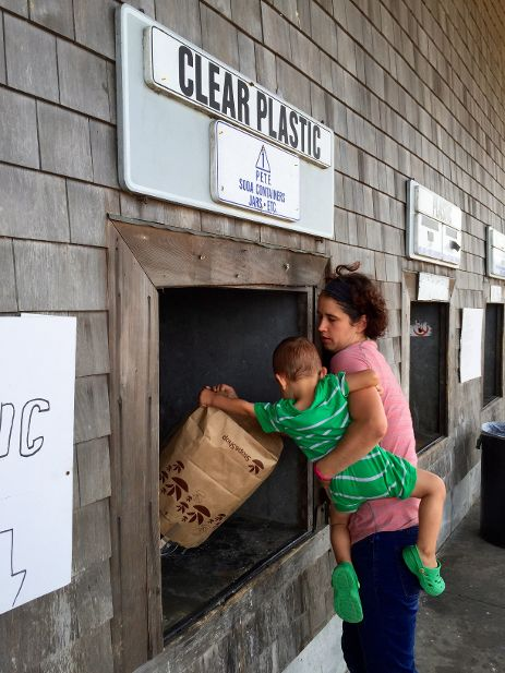 Alison and her son taking recycling to Nantucket's Green Landfill.
