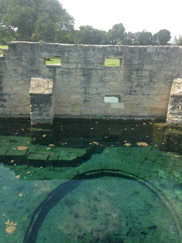 The city stabilized the walls of the historic bathhouse in 2003. You can see the bathhouse outside of the park along Sulphur Springs.