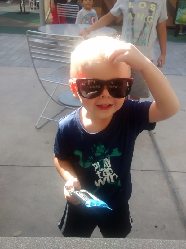Mikey approves of the KIND Bar and shades from Birds Barbershop!